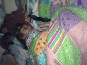 Audra sleeping with her sword by her side