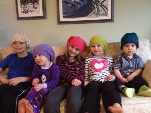 "5 of 7 cousins sporting ""nanny"" hats"