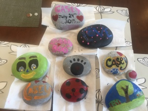 Rocks we painted for when we bury Casey's ashes